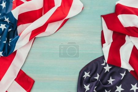 top view of folded american flags on blue wooden surface, presidents day concept