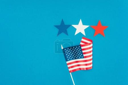 flat lay with arranged american flag and stars isolated on blue, presidents day concept
