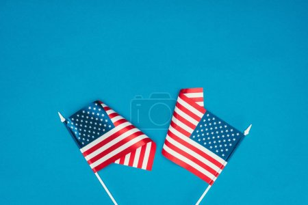 top view of american flags isolated on blue, presidents day concept