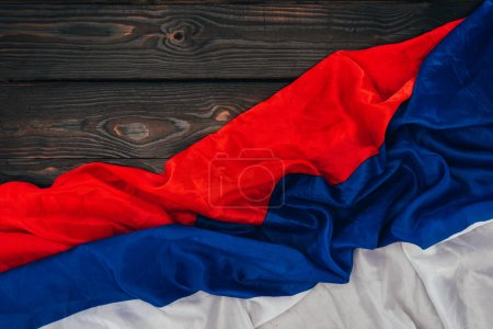 Photo for Close up view of russian flag on dark wooden surface - Royalty Free Image