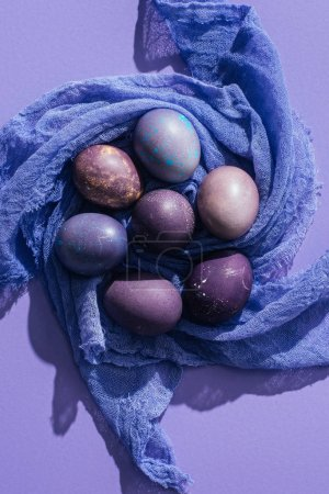Photo for Top view of traditional painted eggs on gauze, on purple - Royalty Free Image