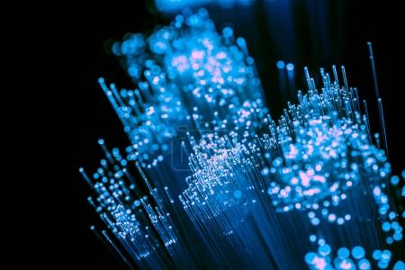 Close up of blurred blue fiber optics background