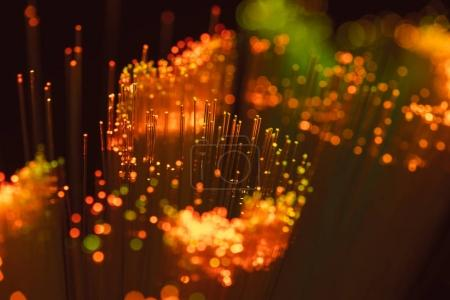 selective focus of shiny orange fiber optics background