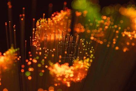 enfoque selectivo de fondo de fibra óptica naranja brillante