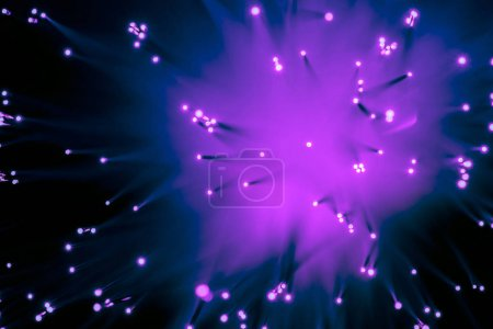 top view background of blurred glowing purple fiber optics