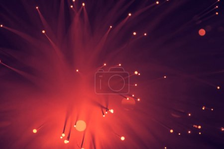top view of glowing red fiber optics texture background