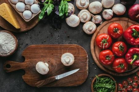 Photo for Top view of different raw ingredients for pizza and knife on concrete surface - Royalty Free Image