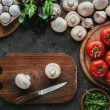 Top view of different raw ingredients for pizza an...