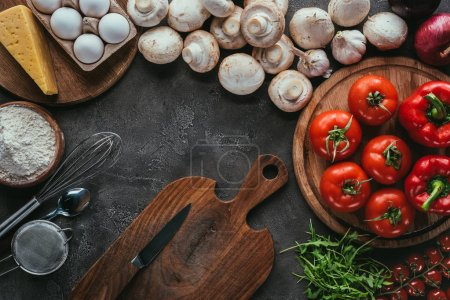 top view of different vegetable ingredients for pizza on concrete surface