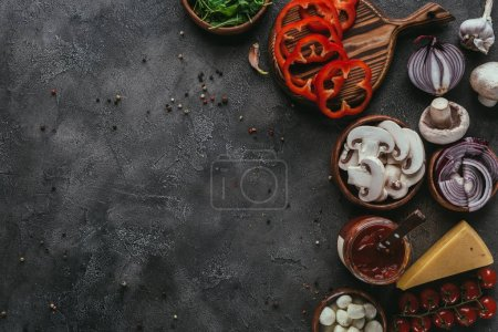 Photo for Top view of raw pizza ingredients on concrete table - Royalty Free Image