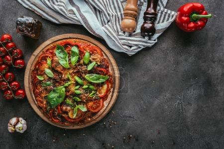Photo for Top view of delicious pizza with ingredients on concrete table - Royalty Free Image