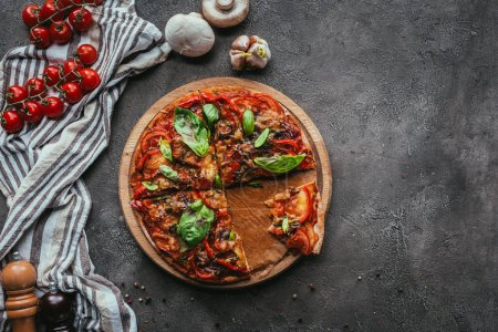Photo for Top view of delicious freshly baked pizza on concrete table - Royalty Free Image