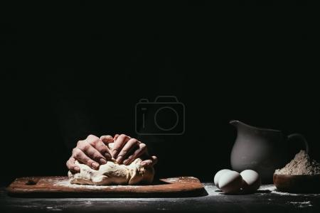 Photo for Cropped shot of person preparing dough on black - Royalty Free Image