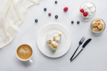 Photo for Top view of delicious piece of cake with berries and coffee on white table - Royalty Free Image