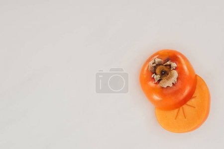 top view of cut persimmon isolated on white