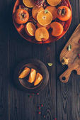 top view of fruits and wooden board on table