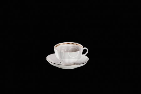 white cup and plate isolated on black