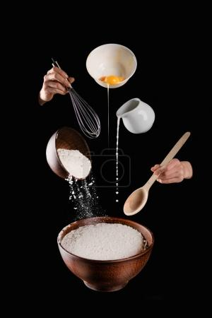 cropped image of woman making pastry isolated on black