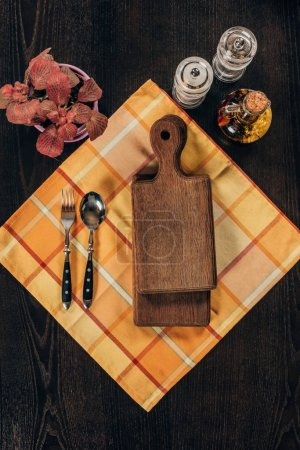 top view of wooden boards with fork and spoon on table