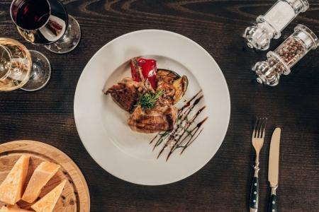 Photo for Top view of grilled chicken with vegetables on plate on table - Royalty Free Image