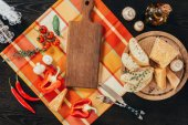 top view of cutting boards with vegetables and parmesan cheese on table