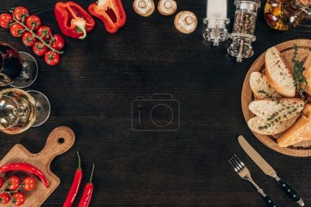 top view of vegetables, bread and wine on table