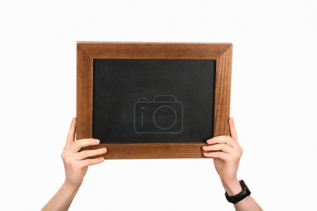 Woman holding empty chalkboard isolated on white
