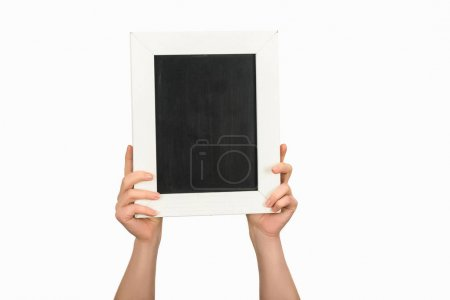Photo for Cropped view of woman holding empty chalkboard isolated on white - Royalty Free Image
