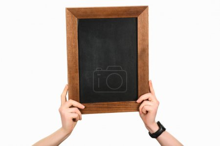 Cropped view of woman hands holding empty blackboard isolated on white