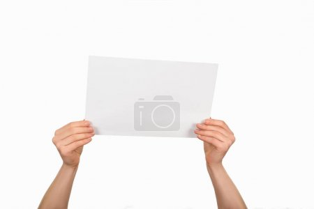 Photo for Cropped image of woman holding empty paper isolated on white - Royalty Free Image