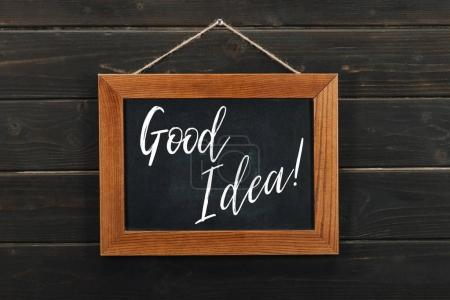 Photo for Board with lettering good idea hanging on wooden wall - Royalty Free Image