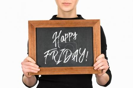 Cropped image of woman holding board with lettering happy friday isolated on white