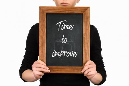 Cropped view of woman holding chalkboard with lettering time to improve isolated on white