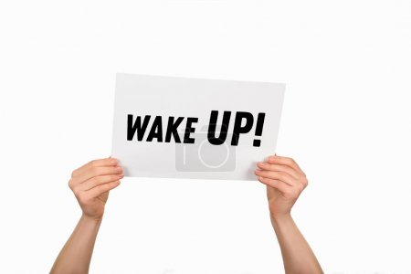 Cropped image of woman hands holding paper with lettering wake up isolated on white
