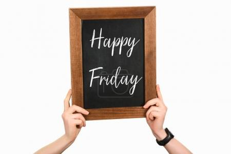 Cropped image of woman hands holding board with lettering happy friday isolated on white