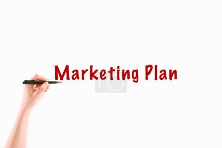 cropped image of woman writing marketing plan inscription isolated on white