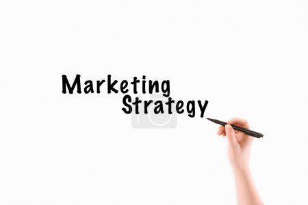 cropped image of woman writing marketing strategy inscription isolated on white