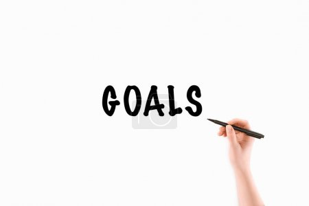 cropped image of woman writing goals inscription isolated on white