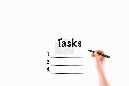 Photo pour Image recadrée de femme écriture tâches inscription isolé sur blanc - image libre de droit