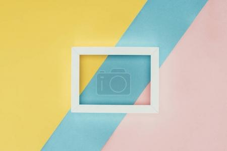 Photo for Top view of white empty wooden frame on colorful background - Royalty Free Image
