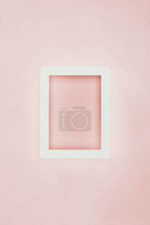 white empty wooden frame on pink background