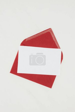 Photo for Top view of red envelope with blank paper isolated on white - Royalty Free Image
