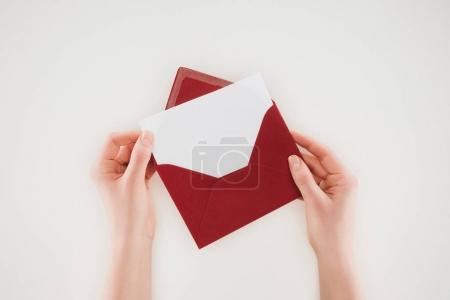 Photo for Cropped shot of woman opening red envelope with blank paper isolated on white - Royalty Free Image