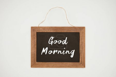 good morning lettering on chalkboard with wooden frame and thread isolated on white