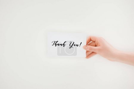 cropped shot of woman holding paper with thank you lettering isolated on white
