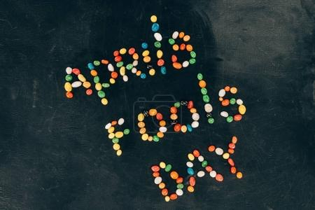 top view of arranged candies in aprils fools day lettering isolated on black tabletop