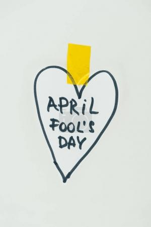 close up view of hand drawn heart and april fools day lettering isolated on grey, april fools day concept