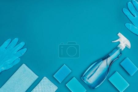 Photo for Top view of blue washing sponges and rubber gloves isolated on blue - Royalty Free Image