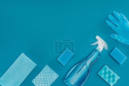 top view of spray bottle with blue washing sponges isolated on blue