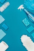 top view of blue cleaning supplies isolated on blue